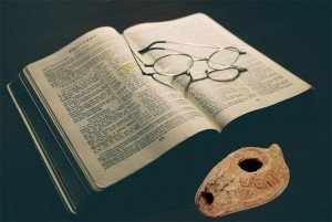 Bible with clay lamp